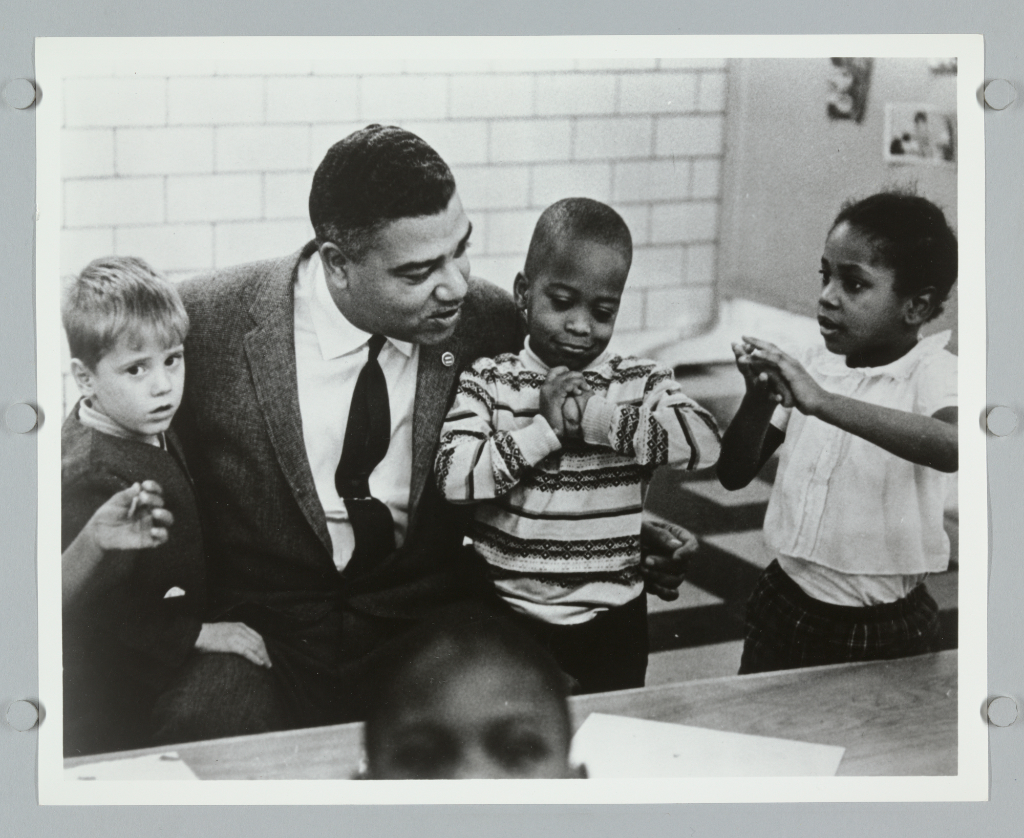 Whitney M. Young with Children in School Setting