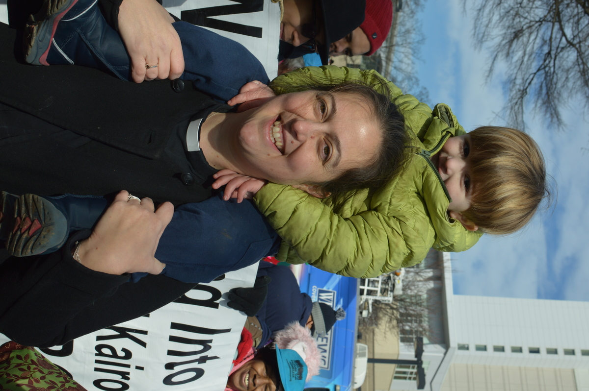 Kairos Center's Rev. Dr. Liz Theoharis (2004, 2014) and her son Luke at the 2015 Moral March in Raleigh, NC