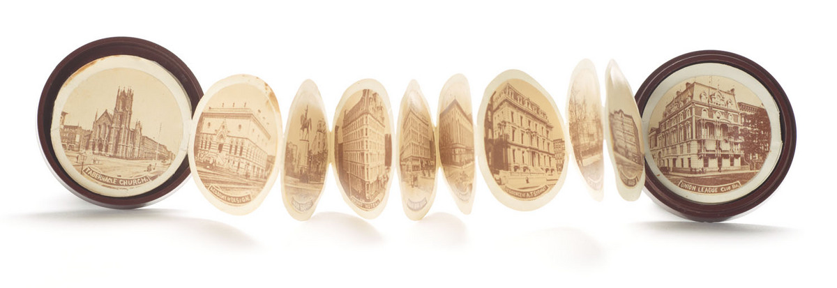 Buildings in New York. Case open showing photographs on accordion folds within