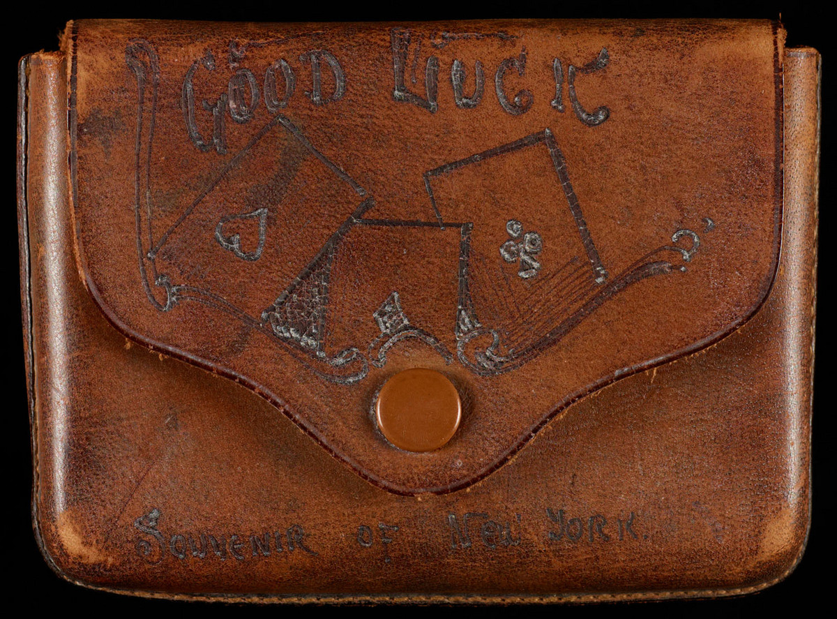 """Souvenir of New York. View of case with """"Good Luck"""" cover"""