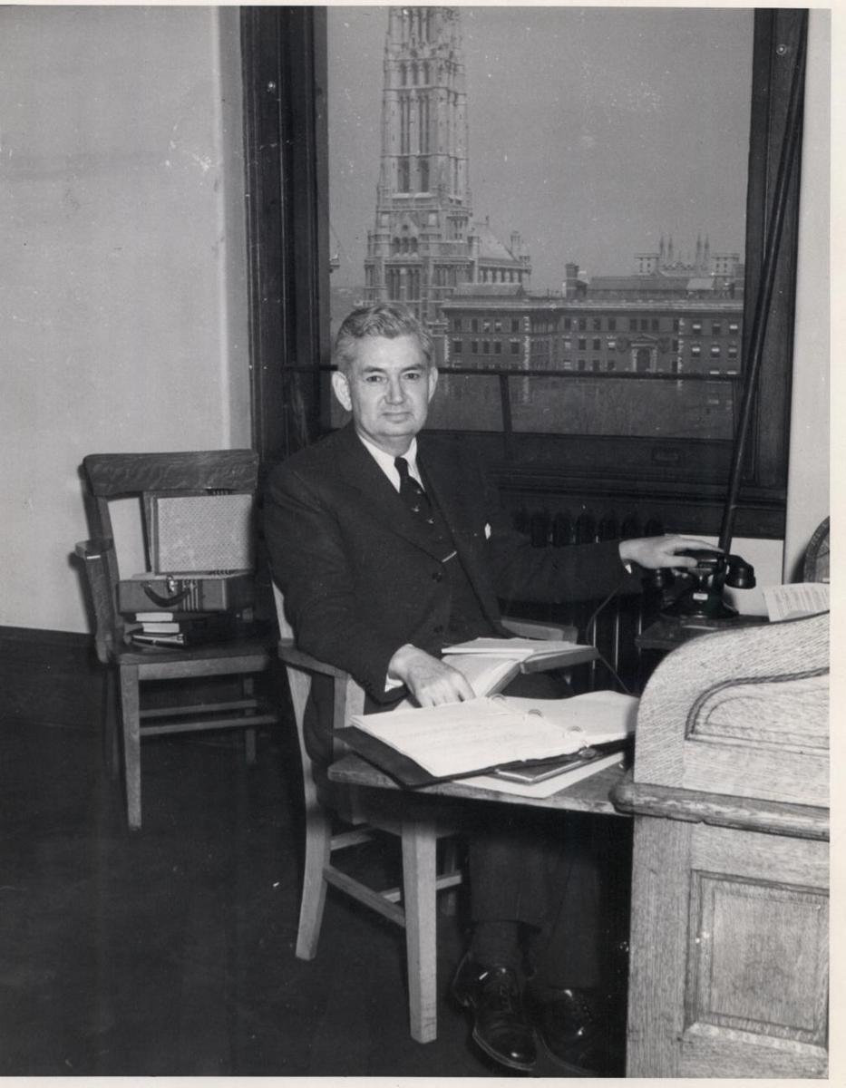 Douglas Moore at Desk