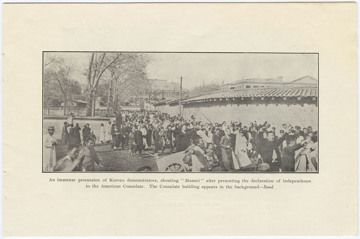 """Immense procession of Korean demonstrators, shouting """"Mansei"""" after presenting the declaration of independence to the American Consulate.  The Consulate building appears in the background--Seoul"""