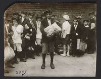 Boy with Package and Group of Children<br />