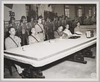 Ho Ying Chin Signing At Table: recto