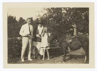 Photograph of Frances Perkins, Paul Wilson, and Susanna Perkins Wilson with a horse
