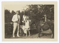 Photograph of Frances Perkins, Paul Wilson, and Susanna Perkins Wilson with a horse