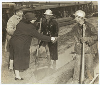Frances Perkins shakes hands with workers at Todd Shipyards