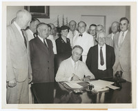President Franklin Delano Roosevelt signing the Social Security Bill, photograph and caption