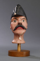 Head of male hand puppet with mustache and bicorne hat worn front-to-back