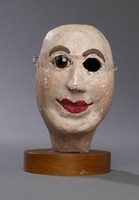 Head of bald male hand puppet, with brown glass eyes