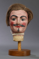 Head of hand puppet with wig, painted moustache and beard