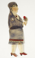 Turkish shadow puppet of woman holding flower