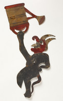 Turkish shadow puppet of Devil holding watering can