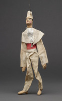 Jigging puppet of male in white shirt and pants with pink belt