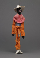 Jigging puppet of black figure with white hat
