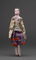 Jigging puppet of female in polka dot top and purple skirt