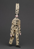 Jigging puppet of clown in white with black polka dots