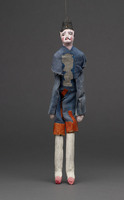 Jigging puppet of male in blue and white cap