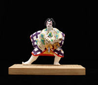 Figurine on stand  of male, fighting, painted white