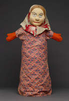 Hand puppet of female with head scarf