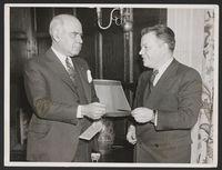 Herbert Lehman buying benefit tickets from David Dubinsky